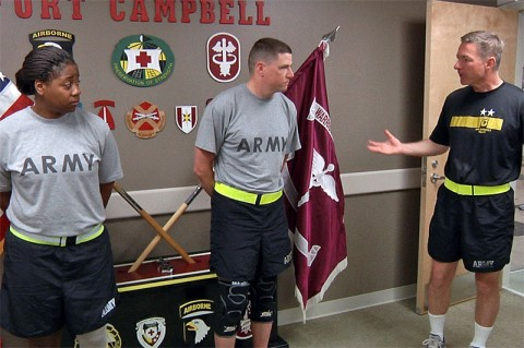 Maj. Gen. James C. McConville talks with Sgt. 1st Class Landon Ranker and Spc. Jasmine Perry about the upcoming Warrior Games.