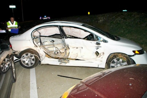 2008 Honda Civic turned in front of EMS Ambulance running Emergency Traffic on Tiny Town Road Tuesday night, April 17th. The ambulance collided with the Civic which then went down an embankment. (Photo by CPD-Jim Knoll)