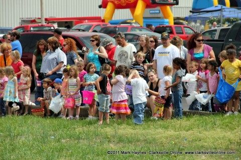 Children await the signal to begin at last year's Easter Egg hunt at Hilltop Supermarket.