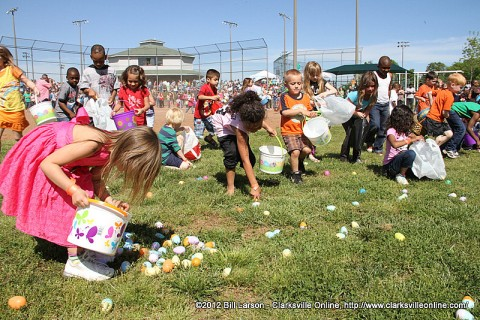 Kids gathering Easter eggs at the 2012 Spring Eggstravanganza on Saturday