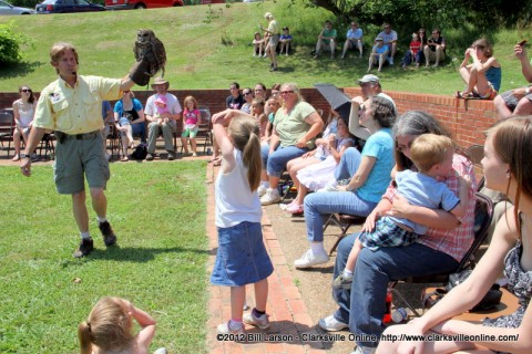 John Stokes from Save Our American Raptors introduces the audience to one of their owls