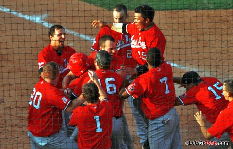 Austin Peay surrounds third baseman Greg Bachman after he scores on a wild pitch to win a 7-6 contest against Jacksonville State, Friday afternoon. Austin Peay Baseball. (Courtesy: Austin Peay Sports Information)