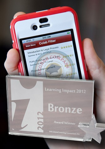 APSU's innovation for student success, Degree Compass (interface seen on a smartphone), won a bronze distinction recently from the IMS Global Learning Consortium in Toronto, Canada, during its worldwide annual competition. APSU was the only American institution to receive an award at the conference. (Photo illustration by Beth Liggett, APSU photographer)