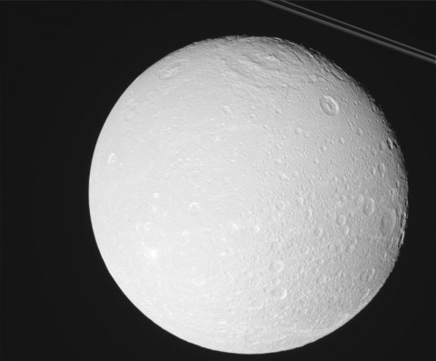 Dione Up Close - This raw, unprocessed image was taken by NASA's Cassini spacecraft on May 2nd, 2012. The camera was pointing toward Dione at approximately 14,835 miles (23,875 kilometers) away. (Image Credit: NASA/JPL/Space Science Institute)