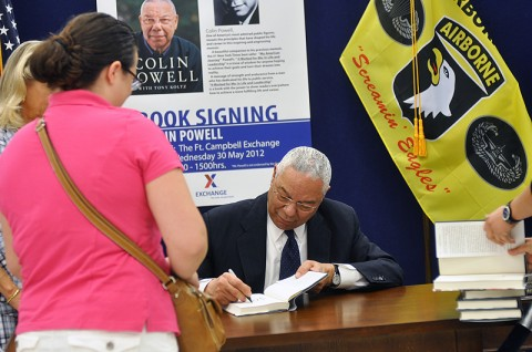 "Jennifer Krog watches as Colin Powell signs a copy of his new book, ""It Worked for Me: In Life and Leadership,"" at Fort Campbell's Post Exchange Wednesday afternoon. Powell, who once served as 2nd Brigade commander for the 101st Airborne Division in 1976, revisited the installation on the Kentucky-Tennessee state line as a part of his book tour. (U.S. Army photo by Megan Locke Simpson, Fort Campbell Courier)"
