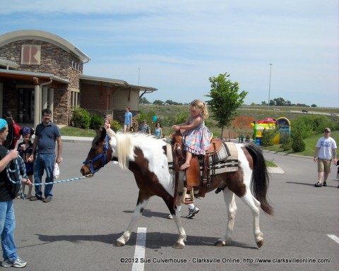 A young girl rides a pony at the Clarksville Association of Realtor's Project F.U.E.L. Fundraiser on Saturday