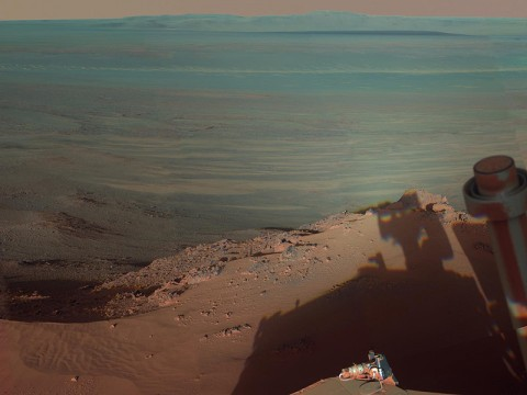 NASA's Mars Rover Opportunity catches its own late-afternoon shadow in this dramatically lit view eastward across Endeavour Crater on Mars. The rover used the panoramic camera (Pancam) between about 4:30pm and 5:00pm local Mars time to record images taken through different filters and combined into this mosaic view. (Image Credit: NASA/JPL-Caltech/Cornell/Arizona State Univ.)