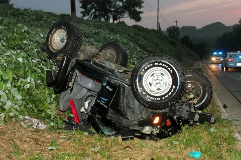 1997 Jeep Wrangler went off the road and down an emabankment off Peachers Mill Road Sunday Morning. (Photo by CPD-Officer Melissa Spielhagen)