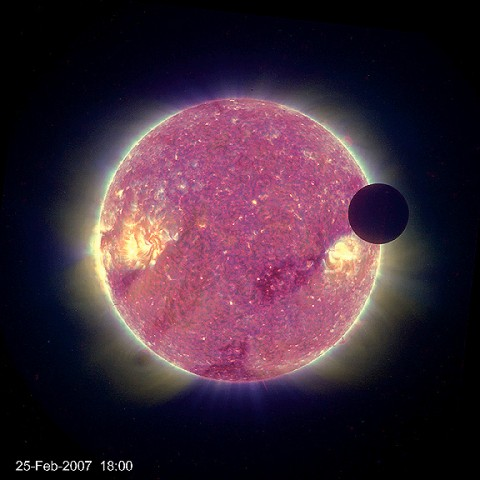 This is a view of the moon transiting, or passing in front of, the Sun as seen from the STEREO-B spacecraft on Feb. 25th, 2007. The Sun is in false color, and the moon appears as a black disk on the upper right. NASA's STEREO mission consists of two spacecraft launched in October, 2006 to study solar storms. (Credit: NASA)