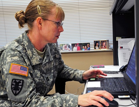 Capt. Elizabeth L. Evans, the human resource officer-in-charge assigned to 2nd Battalion, 506th Infantry Regiment, 4th Brigade Combat Team, 101st Airborne Division, and native of Kennebunk, Maine, consolidates personnel information as part her duties in her new assignment within a maneuver battalion at Fort Campbell, Ky. (U.S. Army photo by Spc. Thomas Christiansen, 1st Battalion, 506th Infantry Regiment, 4th Brigade Combat Team)