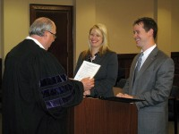 Elizabeth Fendley Hahn and Jacob W. Fendley prepare to be sworn in as attorneys by the Honorable Judge Ray Grimes.