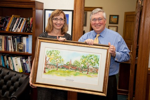 APSU associate professor of history Dr. Minoa Uffelman presents APSU President Tim Hall with a watercolor painting by local artist Lynne Waters Griffey, in recognition of the 40th anniversary of the Sigma Kappa chapter of the Chi Omega Women's Fraternity at APSU. (Photo by Beth Liggett/APSU staff).