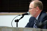 Mike Harrison addressing his fellow board members