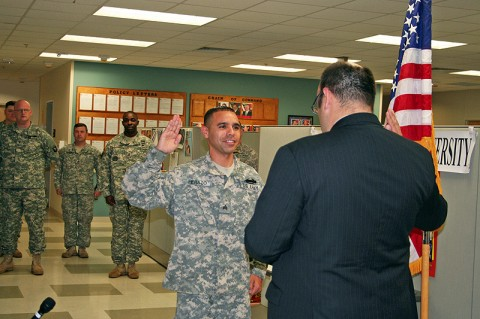 Field Office Director for the U.S. Citizenship Immigration Services in Louisville, Ky. Geoff Verderosa officiated the Naturalization Ceremony for Sgt. Jean C. Herazo May 18th at the Warrior Transition Battalion Complex while members of the Alpha Company, Warrior Transition Battalion observed.