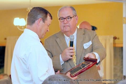Scott Beasley being presented with the Hugh Akerman Alumni of the Year Award  by Alumni Association President Tom Mink
