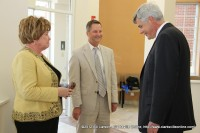 Montgomery County Mayor Carolyn Bowers, State Senator Tim Barnes, and Tennessee Department of Health Chief Medical Officer David Reagan talk in the lobby of the new WIC Clinc