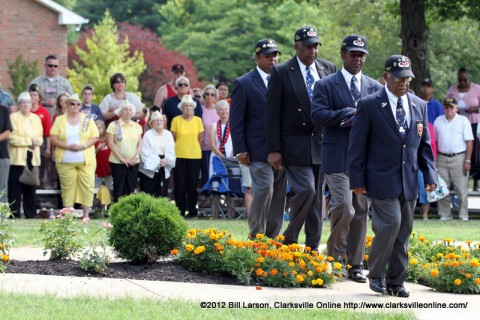 The colors were posted by the Elester Garner Chapter of the 555th Triple Nickel as members of the Gold Star Wives look on during last year's Memorial Day Ceremony.