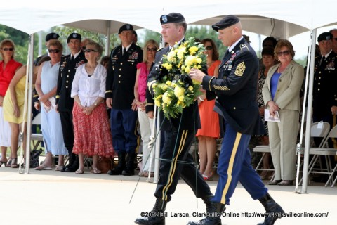 Maj. Gen. James C. McConnell, commander of the 101st Airborne Division (Air Assault), along with Command Sgt. Maj. Scott Schroeder prepare to lay the wreath honoring those of the 101st Airborne Division (Air Assault) has lost through the years, as Montgomery County Mayor Carolyn Bowers looks on from the audience.