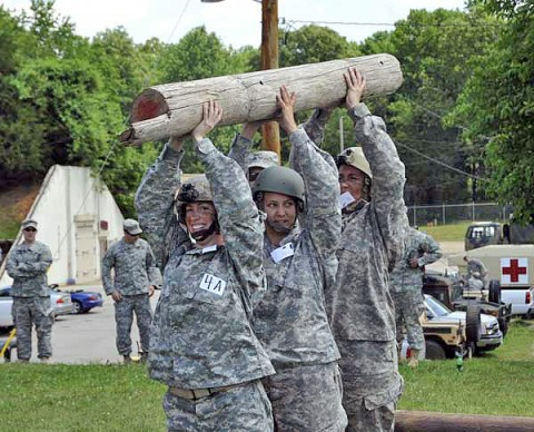 Lady Night Stalkers from 2nd Battalion, 160th Special Operations Aviation Regiment (Airborne) conduct log physical training during the Pink Platoon event May 9th at Fort Campbell, KY. (160th Special Operation Aviation Regiment (Airborne) photo)