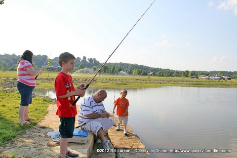 Some young fishermen are getting ready to try their luck at the Liberty Park pond.