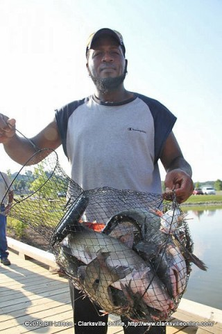 Darrell Cumo shows off his catch.