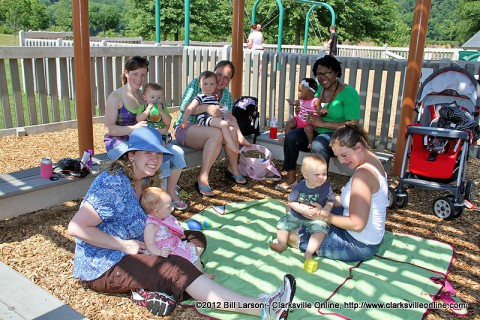 Mothers with the Library Playgroup were meeting with their toddlers at the Clarksville Rotary Club's Where Imagination Flows Playground.