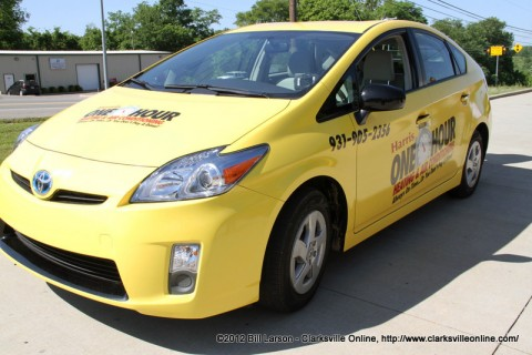 Harris One Hour Heating and Air Conditioning tradeed their F-150 business truck for the small hybrid Toyota Prius car.