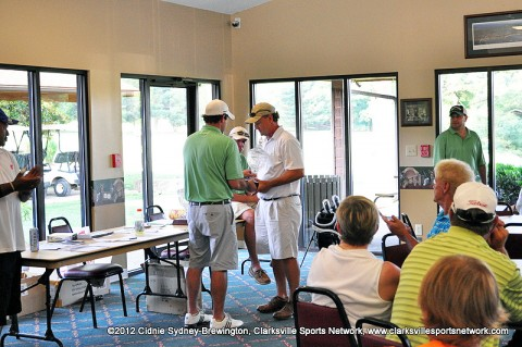 Greg Guinn receives his trophy after winning the 2012 Wendy's Invitational Senior Division title.