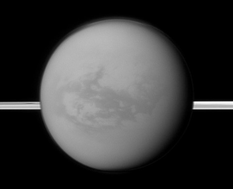 Saturn's rings lie in the distance as the Cassini spacecraft looks toward Titan and its dark region called Shangri-La, east of the landing site of the Huygens Probe. (Image Credit: NASA/JPL-Caltech/Space Science Institute)