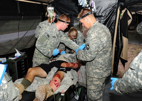 Soldiers from Company C, 801st Brigade Support Battalion, 4th Brigade Combat Team, 101st Airborne Division, treat and stabilize a simulated patient during a mass casualty training exercise June 20th, 2012 at Fort Campbell, KY. (Photo by Staff Sgt. Todd Christopherson)