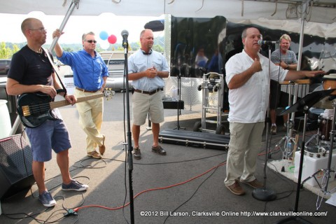 Clarksville Marina general manager Dave signs, addresses the crowd as Ron Cheney (Light Blue Shirt) and Darby Campbell (Dark Blue Shirt) look on
