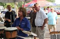 Clarksville Mayor Kim McMillan addressed the crowd as Bill Roberts (white shirt)  looks on