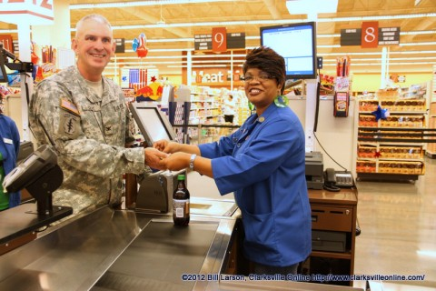 Col. Perry Clark making the first purchase at the New Commissary