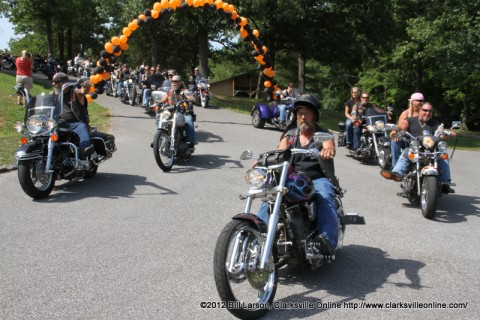 Members of the Bikers Who Care stream into Camp Rainbow to visit with the kids on June 14th 2012