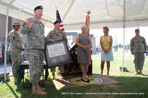 Maj. Gen. James C. McConville, Commander of the 101st Airborne Division (Air Assault) praises Col. Michael P. Peterman and his wife Kathy