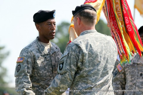 Col. Charles Hamilton accepts the Brigade colors and command of the 101st Sustainment Brigade from Maj. Gen. James C. McConville