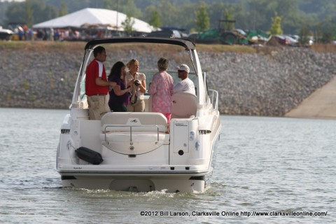 One of the boats from Bill Roberts Thunder Road Automotive and Marine brings Chamber members back in to the docks at Business After Hours on Thursday