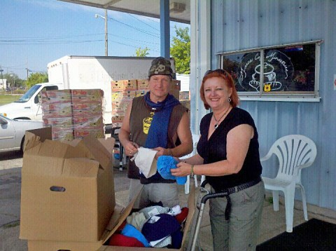 Manna Cafe' volunteer Craig Groomes )left) and Kaye Jones (right) go through the new items that will help keep people warm this winter.