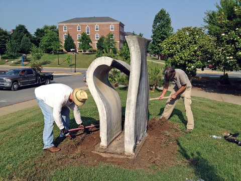 """Christopher Burawa, left, works with artist Mike Andrews to restore Andrew's sculpture, """"Light Modulator."""""""
