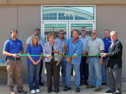 (L to R) Facilities Development employees Joe Woodard; Teresa Cross; Bobby Burns; County Mayor Carolyn Bowers; Matt James; Kenneth Gentry; Marshall Cavin; Bill Harrison; Chad Wilson; and Mike Evans, Industrial Development Board