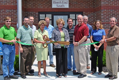 Front Row: Right to Left:  Hershel Kelley, Maintenance Manager River's End South; Brad Miller, Human Resources Administrator, River's End South; Kim McMillan, City Mayor; Carolyn Bowers, County Mayor; John Hooper, General Manager River's End South; Mike Evans, Executive Director of Industrial Development; Kenny Daugherty, Environmental Specialist at Bridgestone Metalpha and CMCGCP Work Committee Member; Kenneth Gentry, Montgomery County Facilities Development Manager; Dave Robertson, Operations Manager, River's End South; Pete Reed, Director of Bi-County Solid Waste Management and Michelle Newell, CMCGCP Manager.
