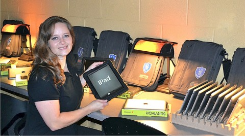 Cara Miller, Director of Technology at Clarksville Academy prepares the iPad3s for launch.