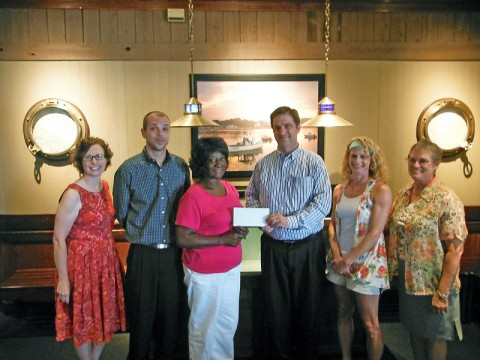 Pictured, from the left, are Beth Kasper, Mt Olive Society volunteer, Jon Rigdon, Longhorn Steakhouse manager, Geneva Bell, Mt Olive Society 2nd vice president, Michael Malone, Red Lobster general manager, Karla Kean, TSU Extension agent, and Joanne Traughber, UT Master Gardeners intern.