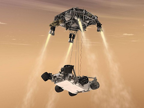 This artist's concept shows the sky crane maneuver during the descent of NASA's Curiosity rover to the Martian surface. (Image credit: NASA/JPL-Caltech)