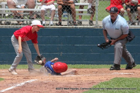 A Goodlettsville player slides under the Montgomery Central tag at home plate in Saturday's Little League (13-14) State Tournament action.