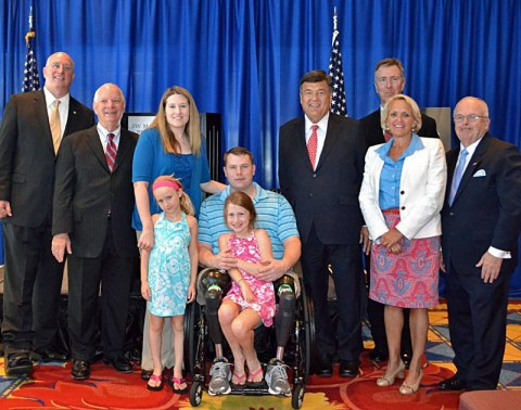 "(left to right): David Coker, President Fisher House Foundation; Senator Ben Cardin; Jessica Allen and her husband; Staff Sgt. Charles ""Chaz"" Allen, US Army and their daughters, Ryann and Deryn Allen; Congressman Dutch Ruppersberger; Mark Nicpon, VP of Marketing, Distribution and CIO, AmericInn; Debbie Marriott Harrison, Senior VP of Government Affairs, Marriott; Joseph A. McInerney, president and chief executive officer of American Hotel & Lodging Association."