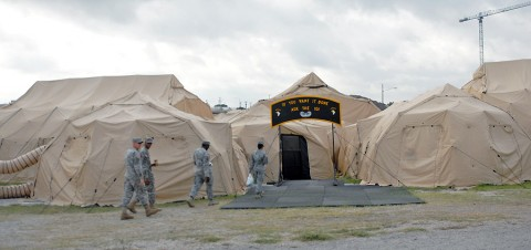 Soldiers from the 101st Airborne Division, Fort Campbell, KY, enter their division's tactical operations center at Fort Hood, Texas, June 15th, 2012. The 101st Airborne Division (Air Assault) sent 149 troops from Kentucky to Texas to participate in the III Corps Warfighter Exercise, part of more than 5,500 Soldiers from 17 units conducting computer-based, simulation-driven event. (Photo Credit: Master Sgt. Brian Sipp, 101st Airborne Division (Air Assault) Public Affairs)