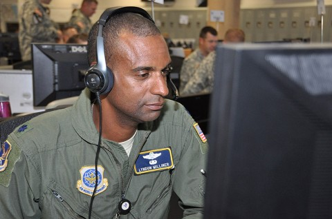 Air Force Lt. Col. Lyndon Milliner, senior air mobility liaison officer with the 615th Contingency Operations Support Group, mans a work station during the III Corps Warfighter Exercise at Fort Hood, Texas, June 15th, 2012. (Photo Credit: Dave Larsen, III Corps Public Affairs)