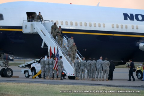 The returning soldiers begin to disembark