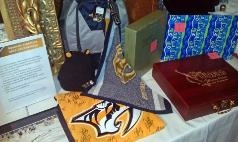 Auction items at the 3rd Annual Mickey Fisher Memorial Golf Tournament Dinner.